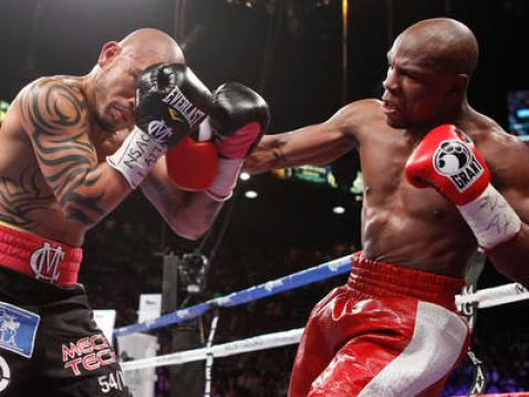 Despite a strong start, Cotto couldn't keep up with Mayweather.